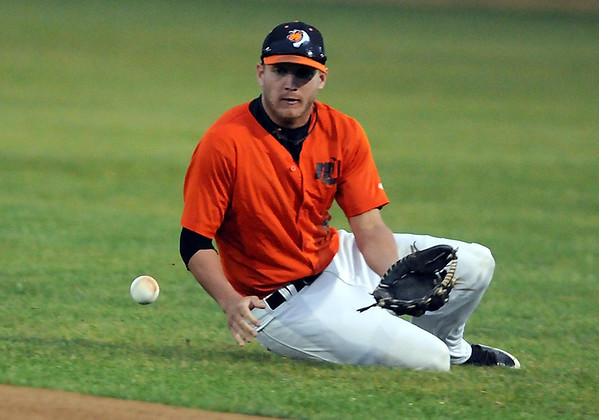 Mankato MoonDogs' Nick Ratajczak makes a sliding stop during the first inning of their rain delayed game against the Duluth Huskies Wednesday at Franklin Rogers Park.