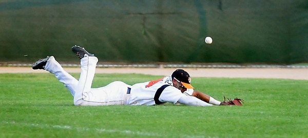 John Cross<br /> Moondogs right fielder Jonathan Rodriguez comes up short trying to snag a foul ball in fourth innning action against the Blue Anchors Friday at Franklin Rogers Park.