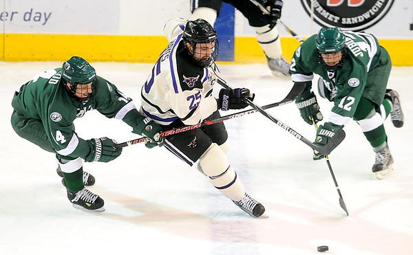 Minnesota State's Eriah Hayes tries to squeeze between Bemidji State defenders Aaron McLeod (14) and Jeff Jubinville (12) during the first period Saturday at the Verizon Wireless Center.