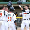 Pat Christman<br /> The Mankato MoonDogs' Josh Fuentes is greeted by teammates after hitting a 3-run home run in the first inning of the first game of a doubleheader against Willmar Thursday at Franklin Rogers Park.