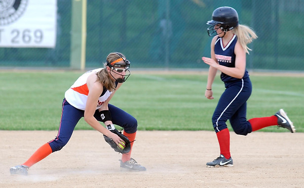 Pat Christman<br /> Mankato Junior Peppers' Krista Goerger fields a ground ball as a Blooming runner streaks by during the first game of a doubleheader Wednesday at Thomas Park.