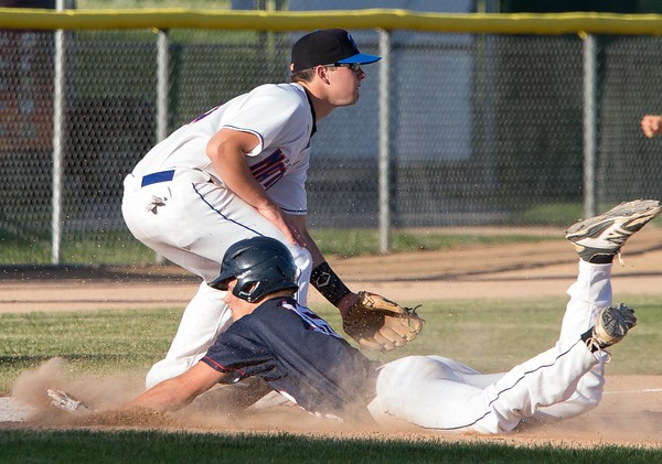 Mankato American Legion's Luke Makovsky slides into third where Mankato National's Ben Heichel is waiting Monday at Franklin Roger's Park. Photo by Trevor Cokley