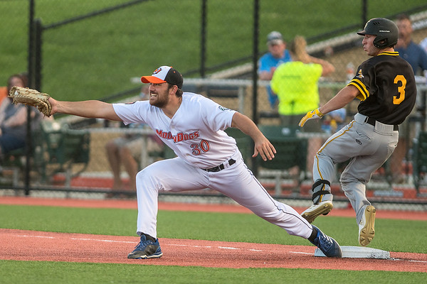 Mankato MoonDogs Andrew Morales stretches out to grab a throw to first base as Willmar's Caleb Ricca begins to signal to the umpire a safe call. Ricca was called out on the play. The MoonDogs won the game 4-3 in 10 innings. Photo by Jackson Forderer