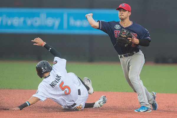 St. Cloud Rox's Ryland Kerr (right) makes a throw to first base in a double play attempt as Nick Novak (5) of the MoonDogs tries a take out slide at second base during Tuesday's game played at Franklin Rogers Park. Photo by Jackson Forderer