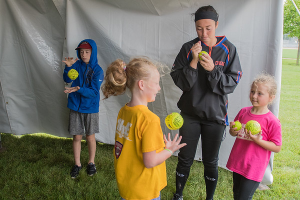 Coley Ries signs softballs for young fans in a tent at Caswell Park on Wednesday. Ries' team, the Chicago Bandits, defeated the Beijing Eagles 6-0 in a game in which Ries pitched 5 shutout innings. Photo by Jackson Forderer