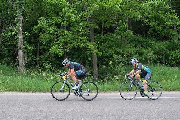 Becky Fjelland Brooks (left) rides along Judson Bottom Road with a group of riders that ride weekly. Fjelland Brooks will be participating in a 24-hour bike race that she has done in the past. Photo by Jackson Forderer