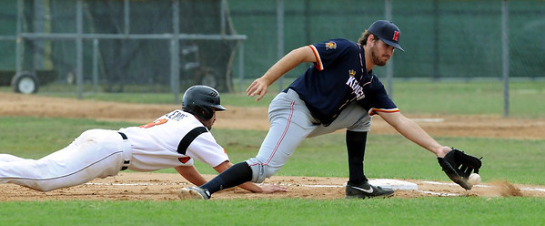 Moondogs Craig Lepre Jr. gets safely back to first on a pick-off throw from home to Kingfish first baseman Zach Ratcliff in the first game of a doubleheader at Franklin Rogers Park on Tuesday. Photo by John Cross