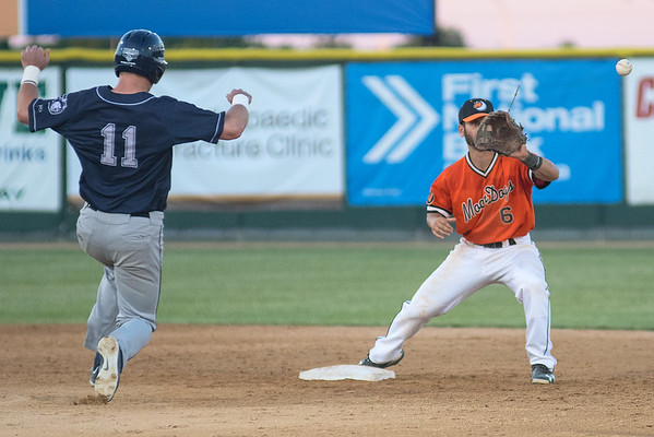 Mankato MoonDogs shortstop Alvaro Rubalcaba (6) waits for the throw to second for a force out on Duluth Huskies' Gabe Knowles (11) during Tuesday's game played at Franklin Rogers Park. Photo by Jackson Forderer