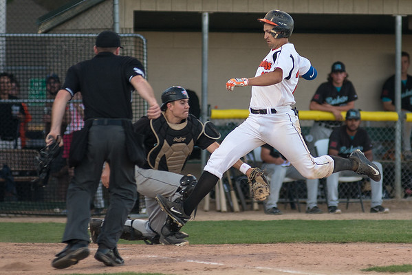 Nick Vaage of the MoonDogs takes the final stride to home after a throwing error at third following his triple in Thursday's game against the Rochester Honkers. The MoonDogs beat the Honkers 9-1. Photo by Jackson Forderer