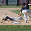 Reese Melvin of the Mankato American Post 11 Legion baseball team slides into third under the tag of Kyle Ziebl of Mankato National.  Photo by Jackson Forderer