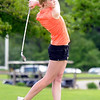Adrienne LeMay of LCWM watches her drive off the tee during the Section 2A golf tournament at North Links on Monday. Photo by John Cross