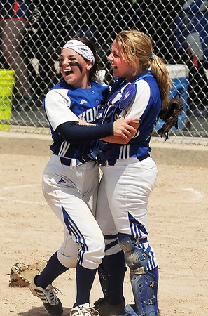 Kasson-Mantorville's battery of pitcher Maddie Damon (left) and catcher Cori Kennedy celebrate after defeating Le Sueur-Henderson 3-0 in the Class AA championship game in the Minnesota State Girl's Softball Tournament in North Mankato on Friday. Damon now holds the Minnesota career strike-out record in girls softball with 1,260. Photo by John Cross