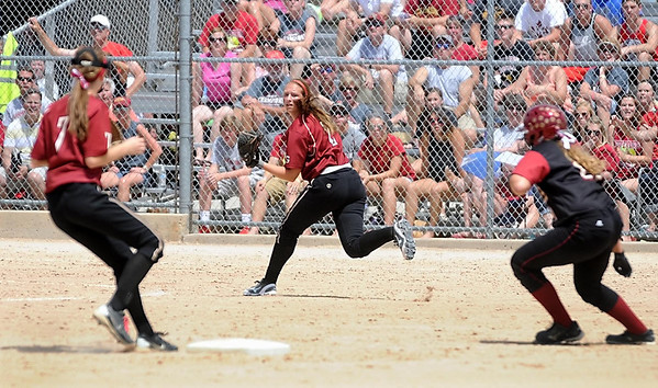 Maple Grove's Shannon McMurphy looks back after making a catch as Lakeville South's Alicia Young scrambles back to second base during the Calss AAA championship game Friday at Caswell Park. Photo by Pat Christman
