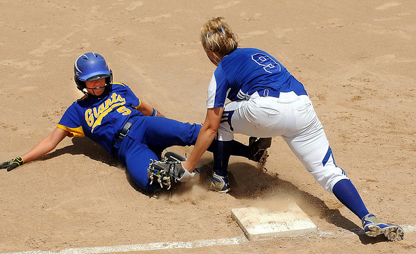 Le Sueur-Henderson's Veronica Sinell is tagged out by Kasson-Mantorville's Aylisha McCaflin while attempted to steal third base during the Class AA championship game of the Minnesota State Girls' Softball tournament on Friday at North Mankato, Minn. Photo by John Cross