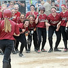 Maple Grove's Jordan Mauch is welcomed home by teammates after hitting a two run home run in the sixth inning of their Class AAA quarterfinal game against Prior Lake Thursday at Caswell Park. Photo by Pat Christman