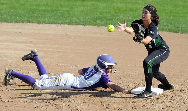 New Ulm's Abby Kamm dives backto second base before the throw gets to Rockford's Hannah Carlson during a Class AA quarterfinal game Thursday at Caswell Park. Photo by Pat Christman