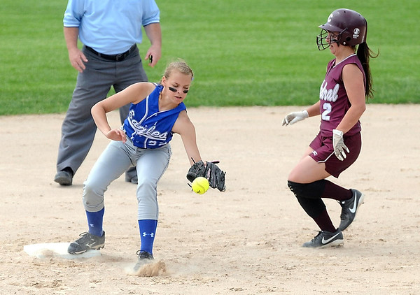 New York Mills' Kaitlyn Kane loses the ball as New Ulm Cathedral's Morgan Shabert slips in to second base behind her during their Class A quarterfinal game Thursday at Caswell Park. Photo by Pat Christman