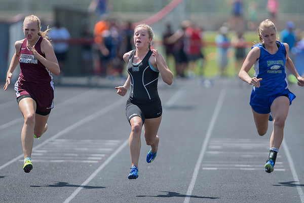 MaeLea Harmon (center) of Waterville-Elysian-Morristown runs in the 100 meter dash at the Section 2A track meet on Saturday. Harmon took first to advance to the state meet with a time of 12.39 seconds. Photo by Jackson Forderer