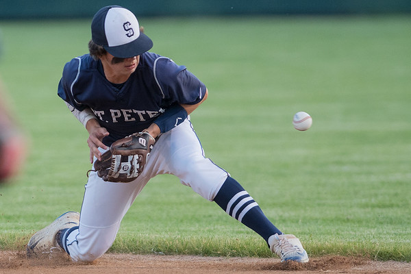 A ground ball gets past St. Peter's Carter Hrdlicka in a section 2AA playoff game against Le Sueur-Henderson played on Tuesday. Photo by Jackson Forderer