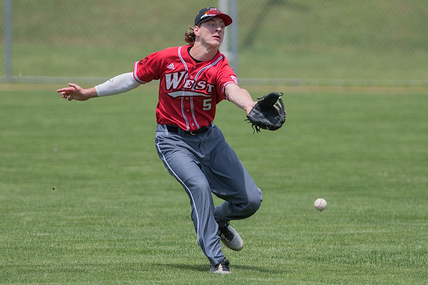 Ben Scott (5) of Mankato West comes up short in an attempt to catch a fly ball in a Section 2AAA playoff game against Marshall. West lost the game 12-1. Photo by Jackson Forderer