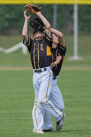 Mankato East's Kawika Hashimoto (right) and Grant Hermer collide while they went after a fly ball in an elimination game against New Ulm on Saturday. Hermer made the catch despite the collision, but the Cougars fell to New Ulm 10-7. Photo by Jackson Forderer