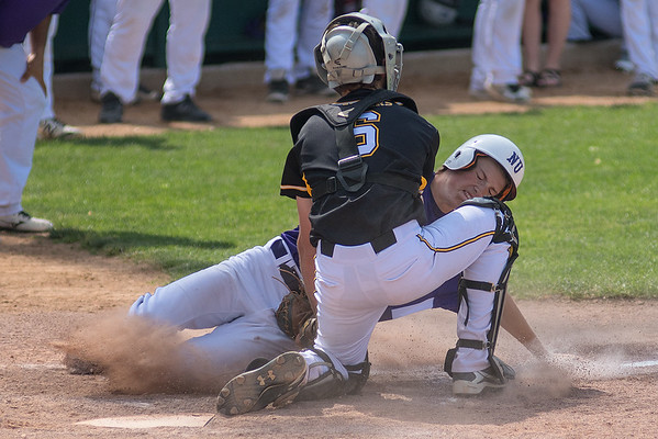 Mankato East catcher Jackson Keller tags out New Ulm's Riley Hansen in a Section 2AAA elimination game played in New Ulm on Saturday. New Ulm rallied to win 10-7. Photo by Jackson Forderer