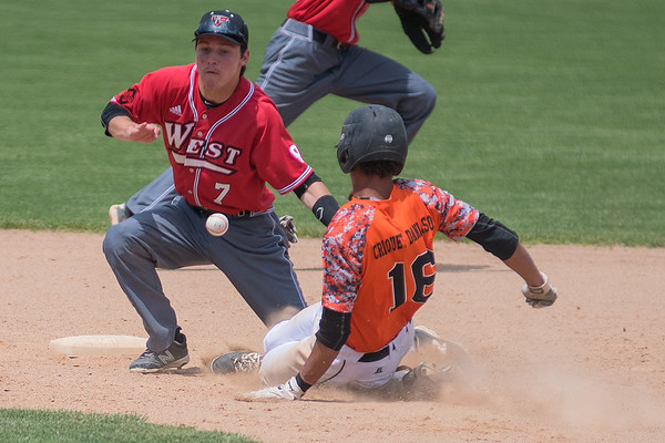 Dylan Criquet-Danielson (16) of Marshall slides into second base ahead of a throw to second basemen Thomas Yokiel (7) of Mankato West in a Section 2AAA playoff game. The Scarlets lost 12-1 in six innings against Marshall. Photo by Jackson Forderer