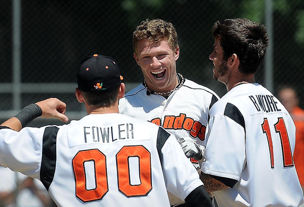 John Cross<br /> MoonDog Craig Massoni is all smiles as he is greeted at homeplate by teammates after hitting the first of his two homeruns Monday against Willmar at Franklin Rogers Park.