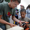 John Cross<br /> Brady Havemeier gets some help from William Uber constructing a wood duck nesting box Saturday at a NWTF Jakes Youth Day at the Nicollet Conservation Club.