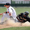 MoonDog Nick Ratajczak successfully puts the tag on Willmar's Kenyy Roberts during a steal attempt in sixth inning action Monday at Franklin Rogers Park.