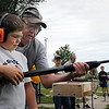 John Cross<br /> Jaden Neubauer gets some gun handling instructions from Tom Rieke before trying his hand at trap shooting during a Youth Day at the Nicollet Conservation Club, Saturday.