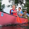 John Cross<br /> Rhett Oelke (left), Jack Cahill (center), try their hand at paddling with Terry Vollmer at a Youth Day at the Nicollet Conservation Club.