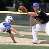 Viroqua's Derek Schultz gets back to first base ahead of the throw to Mankato National's Drew Quame during their game Friday at Wolverton Field.