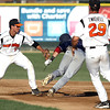 Pat Christman<br /> The Mankato MoonDogs' Josh Fuentes (left) and John Michael Twichell catch St. Cloud baserunner Brad Strong in a rundown during the second inning Thursday at Franklin Rogers Park.