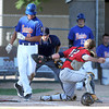 Pat Christman<br /> Mankato Legion National's Shane Sellner sneaks in to home before Mankato American catcher Patrick Rohlfing can tag him during the fifth inning of the first game of a doubleheader Wednesday at Franklin Rogers Park.