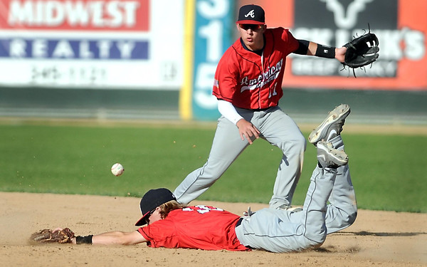 Pat Christman<br /> Mankato Legion American second baseman Derek Helms can't make the diving catch as teammate Jordan Grams backs him up during the fifth inning of the first game of a doubleheader against Mankato National Wednesday at Franklin Rogers Park.