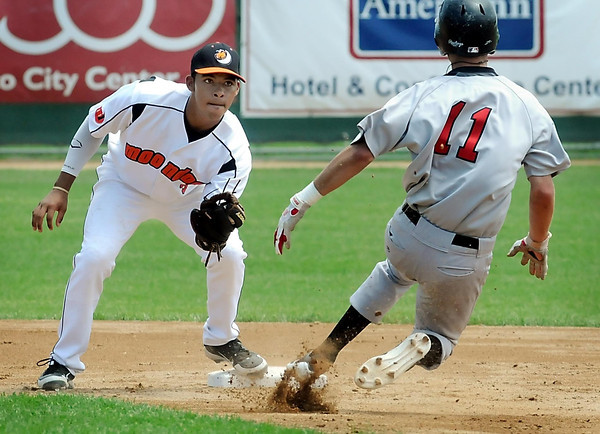 John Cross<br /> Moondogs second baseman Alex Polston prepares to  tag Border Cats base runner Kyle Westhuis during an unsuccessful steal attempt in the second inning.