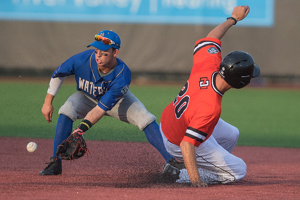 Mankato MoonDogs' Kenton Crews (right) slides safely into second base ahead of a throw caught by Waterloo's Kevin Welsh. The MoonDogs beat the Waterloo Bucks 9-1. Photo by Jackson Forderer