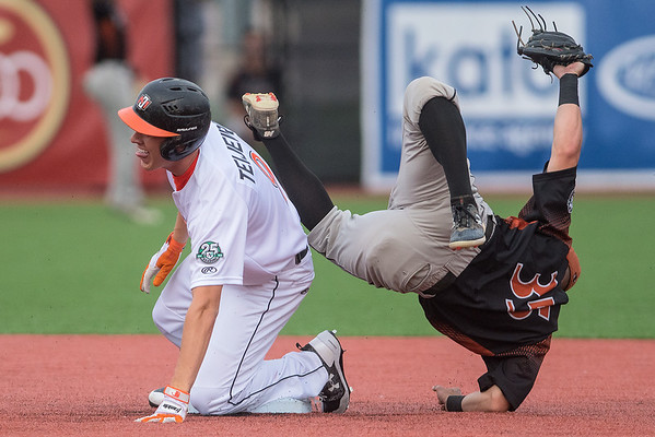 Tommy Gillman (35) of the Eau Claire Express is upended by RJ Teijeiro of the MoonDogs in a game played on Thursday at Franklin Rogers Park. Gillman held onto the ball to tag out Teijeiro who tried to stretch a single in a double. The MoonDogs won the game 6-0. Photo by Jackson Forderer