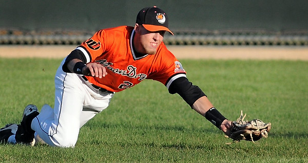 Mankato MoonDogs right fielder Brinn Bell dives to make a catch during a game against Waterloo Wednesday at Franklin Rogers Park. Photo by Pat Christman