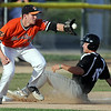 Alexandria's Roman Collins slides in to third base ahead of the throw to Mankato MoonDogs' Derek Umphres during a game Friday at Franklin Rogers Park. Photo by Pat Christman