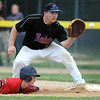 Mankato Legion American's Dylan Hayenga dives back to first base ahead of the throw to Legion National's Conor Wollenzein during a game Thursday at Wolverton Field. Photo by Pat Christman