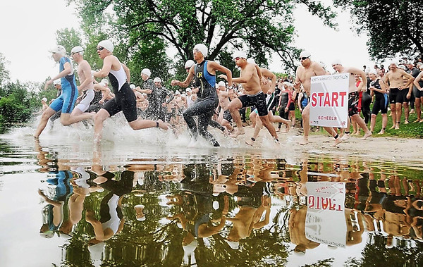 Wright Braudt<br /> The swimmers take off to start the first leg of Saturday's Triathlon at Hiniker Pond.