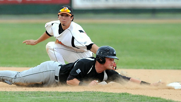 Alexandria's Aaron Gretz slides past the tag of Mankato MoonDogs shortstop Logan Gray and back to second base during a game Thursday at Franklin Rogers Park. Photo by Pat Christman