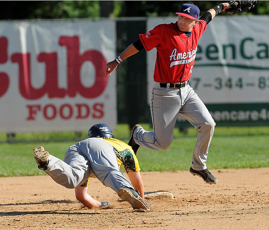 Riverfalls base runner Lucas Luedtke gets safely back to second as Mankato American shortstop Jordan Grams snags a high pick-off through from the catcher during an opening game of the Annual Mulvihill Invitational at Wolverton Field on Saturday.