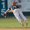 Eau Claire's shortstop Justin Evans (8) makes a diving play on a roundball in the second game of a double header against the MoonDogs. Evans was not able to make a throw to first on the play. The MoonDogs won the first game 14-0. Photo by Jackson Forderer