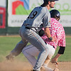 Zac Wiley (20) of the Mankato MoonDogs unsuccessfully tries to break up a double play by sliding into Mitch Gallagher (19) of the Bismarck Larks. Photo by Jackson Forderer