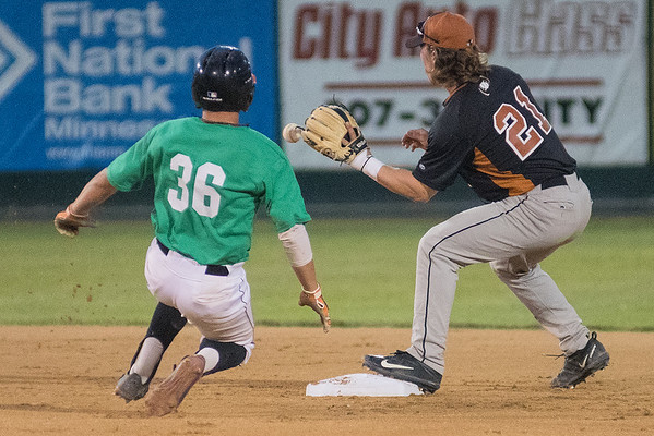 Eau Claire's Scott Ogrin (21) gets the ball just in time to make a force out on Ethan Valdez (36) of the MoonDogs in the second game of Thursday's double header. The MoonDogs won the first game 14-0 in seven innings. Photo by Jackson Forderer