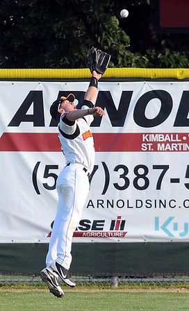 MoonDogs' right fielder Craig Massoni lunges for a ball during their game against Alexandria Tuesday.