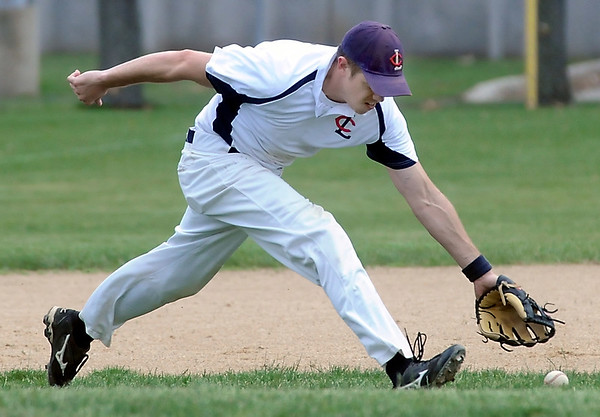 John Cross<br /> Lake Crystal  third baseman Charlie Hauser runs down a grounder in a game against the Mankato Cubs Saturday.
